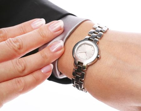 Businesswoman looks at his watch Stock Photo - 6608195
