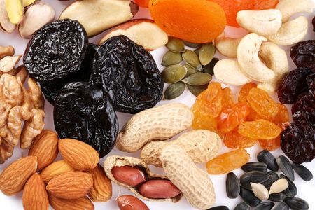 Close seeds and dried fruits on white background Stock Photo - 6649340