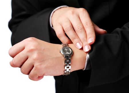 Businesswoman looks at his watch Stock Photo - 6649366