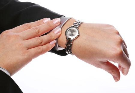 wrist: Businesswoman looks at his watch Stock Photo