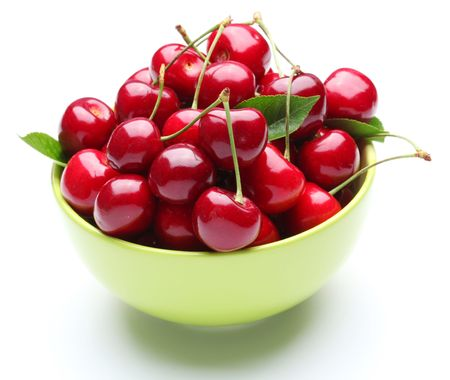Crockery with ripe cherries. Isolated on a white background. Stock Photo - 7531367