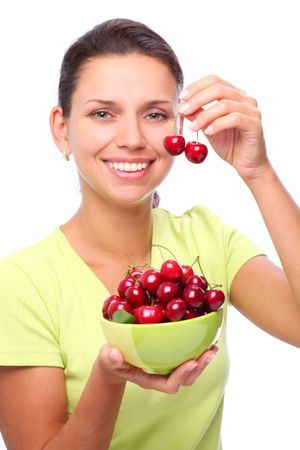 Smiling young woman with bowl full of ripe cherries in her hands. photo