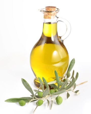 Branch with olives and a bottle of olive oil isolated on white photo