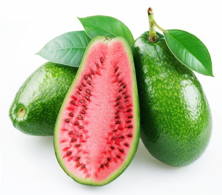 Flesh of watermelon on the cut avocado. Product of genetic engineering. Computer assembly. Stock Photo