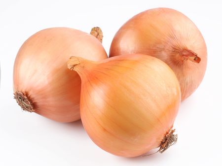 Fresh bulbs of onion on a white background photo