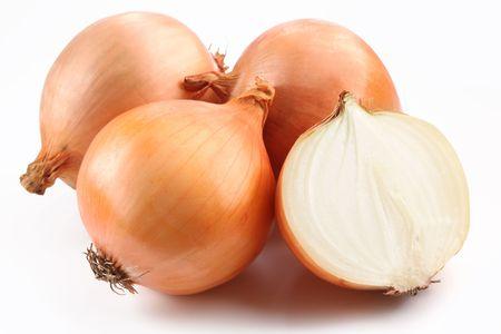 Fresh bulbs of onion on a white background photo