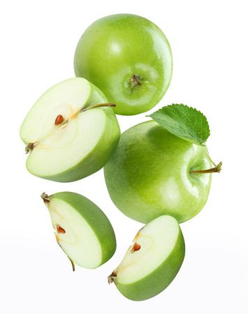 Falling apple and apple pieces  Stock Photo
