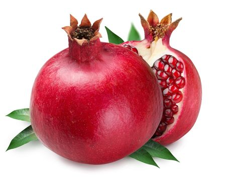 Pomegranate and half of pomegranate on back. Isolated on a white background.