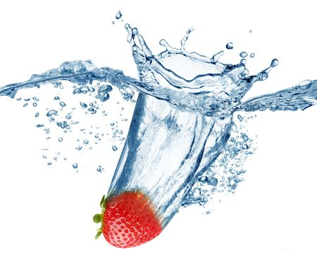 Strawberry falls deeply under water with a big splash. photo