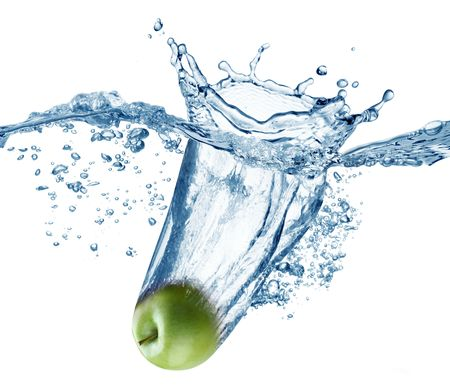 falling water: Apple falls deeply under water with a big splash.