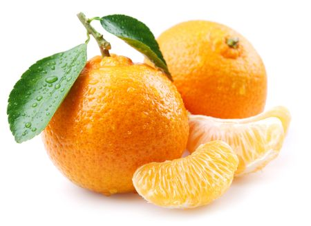 Ripe tangerines with leaves and slices on white background Stock Photo - 7836319