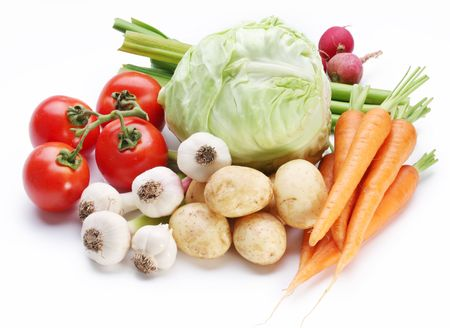 Group of fresh vegetables on white background photo