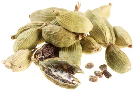 asian flavors: Cardamom seeds on a white background Stock Photo