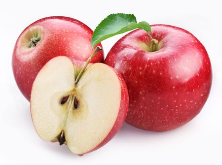 Two ripe red apples and half of apple. Isolated on a white background.