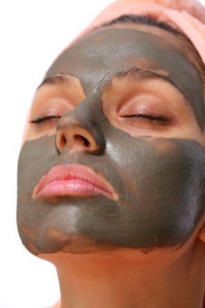 masked woman: Cara de una mujer joven con m�scara de barro en �l.