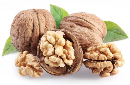 walnuts: Walnuts with leaf isolated on a white background. Stock Photo