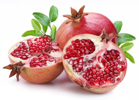 sepal: Juicy opened pomegranate with leaves. Isolated on a white background.
