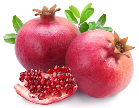 tropical fruits: Juicy pomegranates and its section. Isolated on a white background.