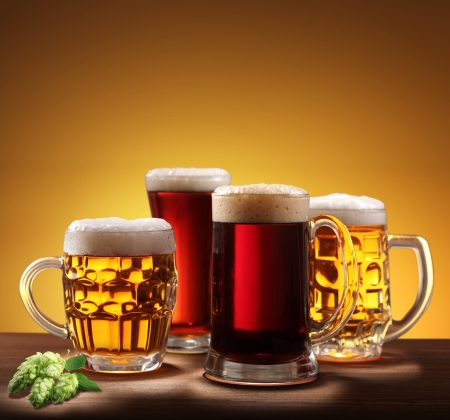 Still-life with beer glasses. On a yellow background. Stock Photo - 8296229