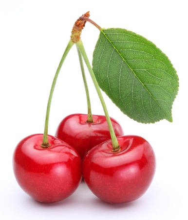 pulpy: Three cherries with leaf isolated on a white background.