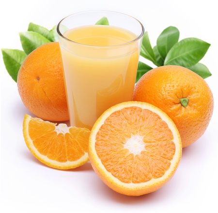 Full glass of fresh orange juice and fruits near it. Isolated on a white. Stockfoto