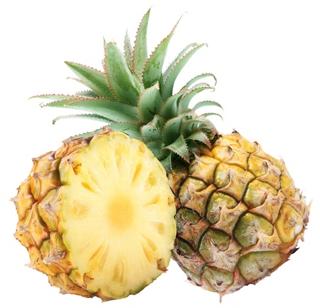Pineapple with rich green rosette  and half of fruit. Isolated on a white. photo