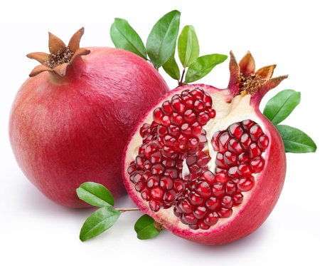 exotic fruit: Juicy pomegranate and its half with leaves. Isolated on a white background.