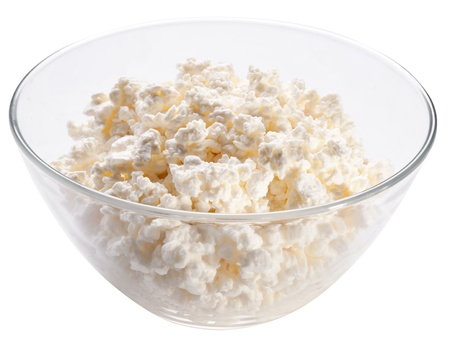 curd: Bowl with fresh cottage cheese. Isolated on a white. Stock Photo