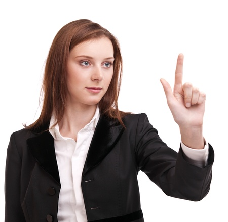 pushes: Young woman in business suit pushes on glass with finger. Isolated on a white background. Stock Photo
