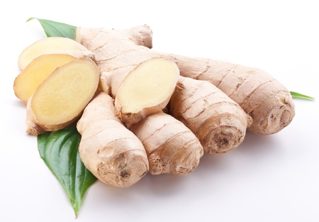 Fresh ginger with leaves isolated on white background. photo