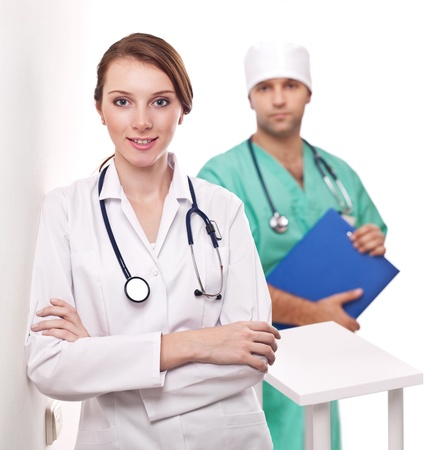 Portrait of doctor with her colleague in the background.  photo