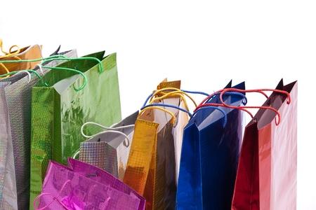 shopaholism: Colourful shop bags isolated on white background. Stock Photo