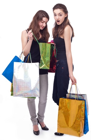 Image of two girls with their purchases. Isolated on white background. Stock Photo - 8718505