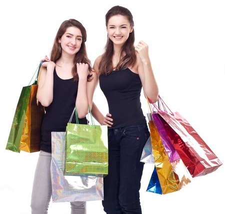 Image of two girls with their purchases. Isolated on white background. Stock Photo - 8718484