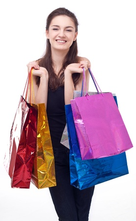 Image of girl with their purchases. Isolated on white background. Stock Photo - 8720239