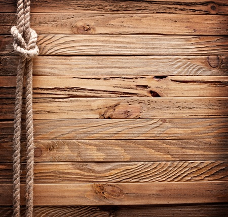 natural rope: Image of old texture of wooden boards with ship rope.