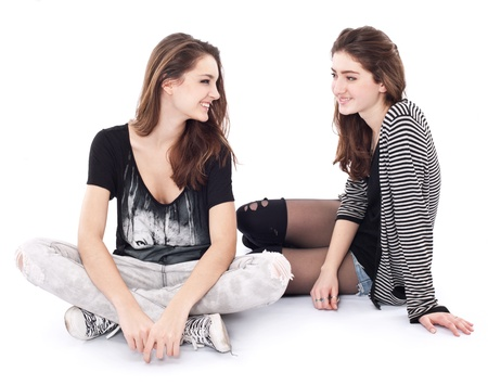 blab: Two friends talking to each other. The image is isolated on a white background.