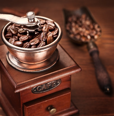Roasted coffee beans are ground in a coffee grinder. photo