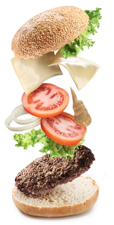 HAMBURGESA: Conceptual - volando ingredientes de hamburguesa.