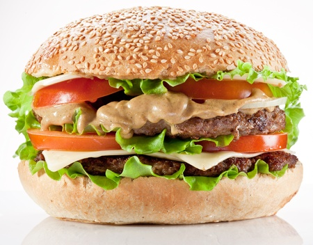 burger on bun: Tasty hamburger on white background. Stock Photo