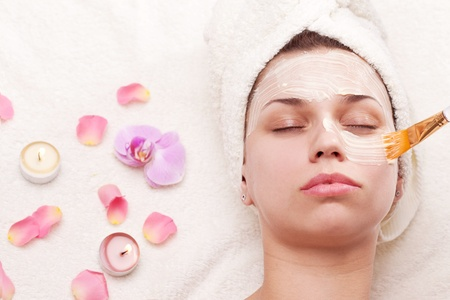 soothing: Applying of soothing mask, young woman getting spa procedures.