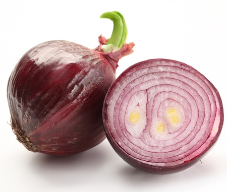 onion isolated: Bulbs of red onion with green leaves on a white background. Stock Photo