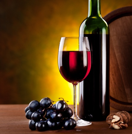 Still life with wine bottle, glass and oak barrels. Stock Photo - 9074313