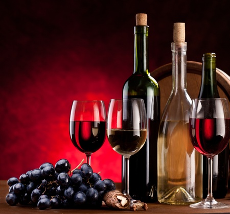 Still life with wine bottles, glasses and oak barrels. Stock Photo - 9074340