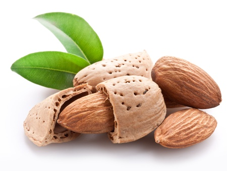 nut shell: Group of almond nuts with leaves. Isolated on a white background.