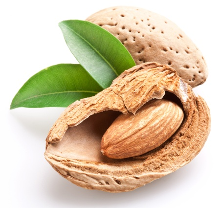 nutshells: Group of almond nuts with leaves. Isolated on a white background.