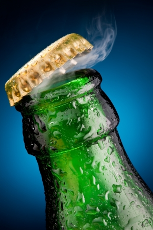green bottle: Opening of beer cap with the gas output Stock Photo