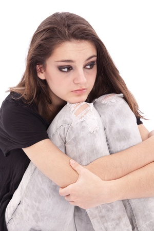 twining: Sad girl teenager sits twining arms about legs
