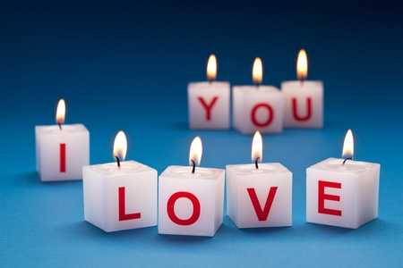 burning love: I love you printed on candles.
