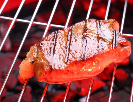 Hot  beefsteak on barbecue Stock Photo - 9247778